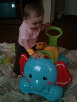Loving her elephant scooter
