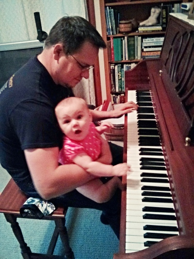Nora loves to play piano with Daddy!